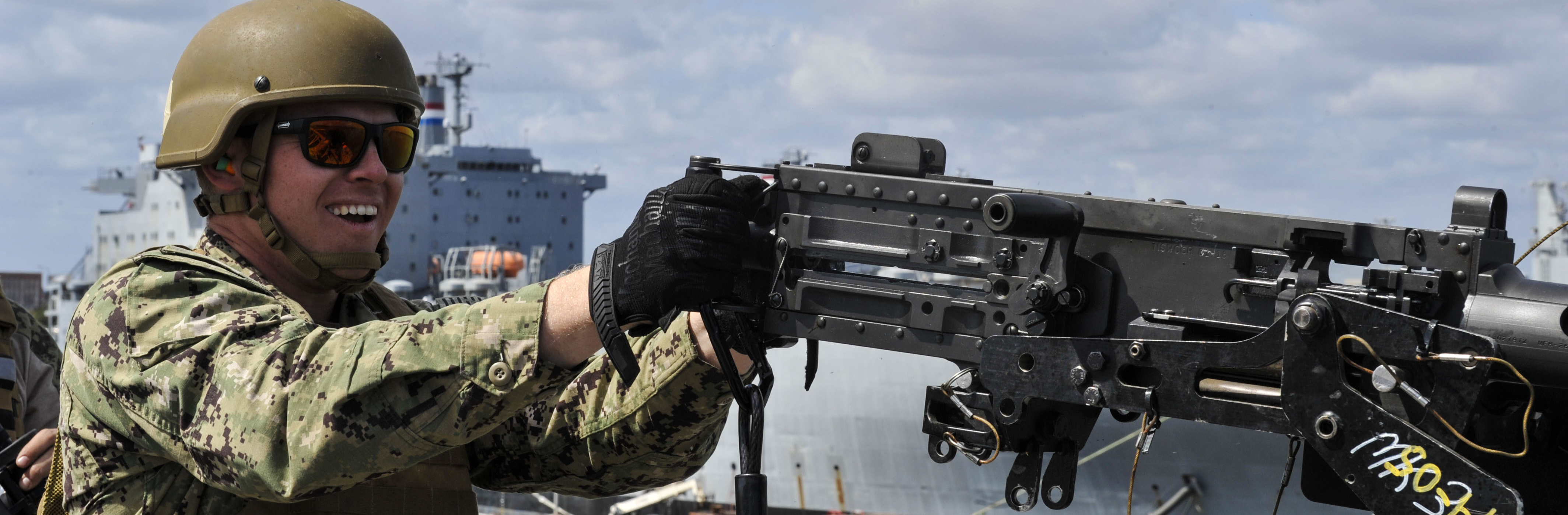 Master-at-Arms Petty Officer 3rd Class Adam Bolas, Coastal Riverine Squadron 10 Bravo 2nd Platoon, fires a 50 caliber machine gun outfitted with blank fire adapters March 14, 2019, at Joint Base Charleston, S.C. – Naval Weapons Station, as part of a maritime exercise to demonstrate tactical team movements, blank firing drills, entry control point drills and simulated enemy fire, among other security skillsets on the Cape Douglas, a logistics Naval vessel. The training was integrated between CRS 10 Bravo 1st Platoon and CRS 10 Bravo 2nd Platoon.